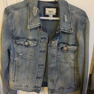 Light wash distressed denim jacket